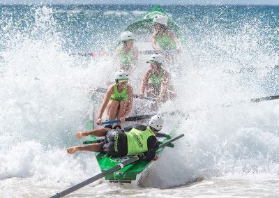 surf boat rowing in big waves