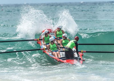 women surf boat rowing