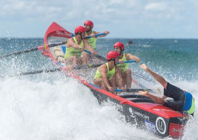 men surf boat rowing