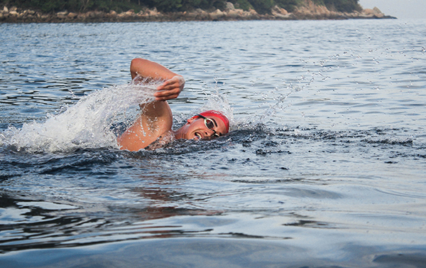 swimmer with red cap