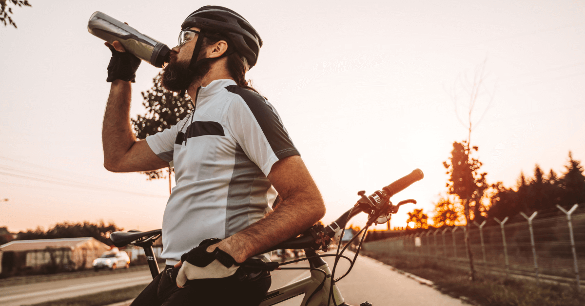 cyclist drinking energy drink