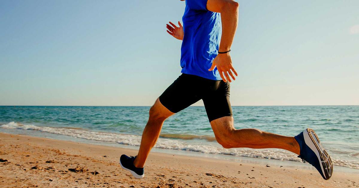 man running along the beach