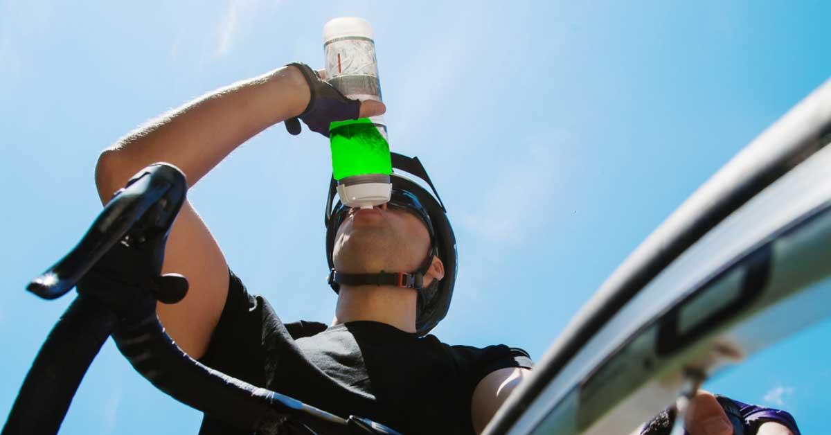 cyclist drinking staminade